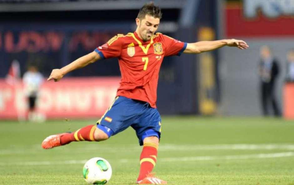 David Villa em ação pela seleção espanhola, onde conquistou uma Eurocopa e uma Copa do Mundo (AFP) Foto: Lance!